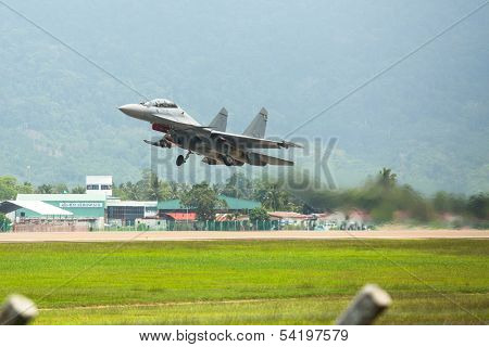 LANGKAWI, MALAYSIA - MAR 26: Su-30MKM (Sukhoi, NATO reporting name: Flanker-C) performing during on LIMA13 Langkawi International Maritime & Aerospace Exhibition on Mar 26, 2013 in Langkawi, Malaysia.