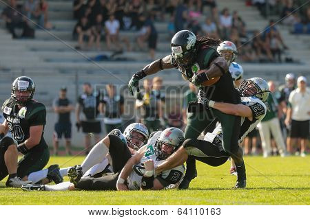 VIENNA,  AUSTRIA - JUNE 8 DB Markus Krause (#21 Raiders) tackles RB Tunde Ogun (#1 Dragons) during the AFL football game on June 8, 2013 in Vienna, Austria.