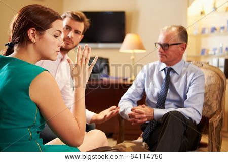 Young Couple Talking To Male Counsellor