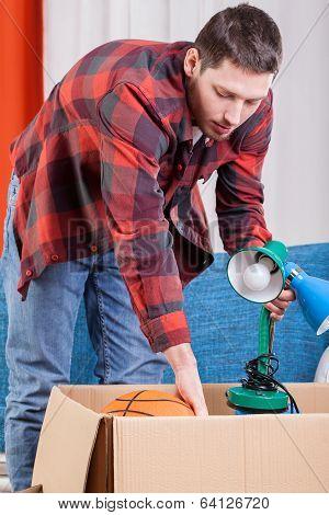 Man Packing Lamp