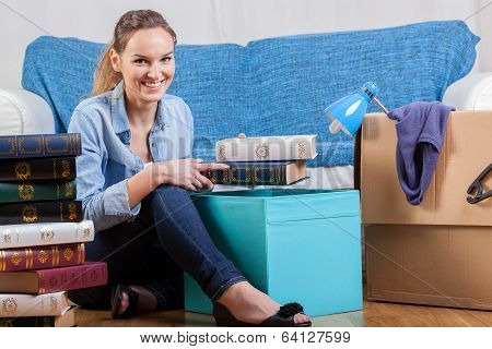 Smiling Woman Packing Books
