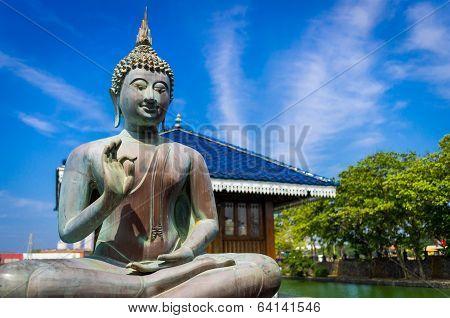 Buddha in Gangarama Buddhist Temple, Sri Lanka poster