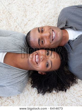 Smiling Afro-american Couple Lying On The Floor
