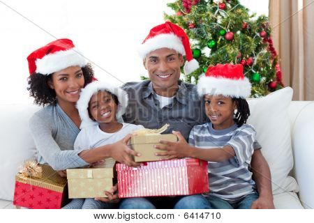Smiling Afro-american Family Sharing Christmas Presents