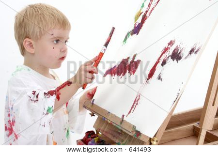 Addorable Toddler Boy Painting At Easel