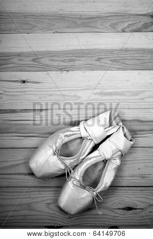 Pair Of Ballet Shoes Pointes On Wooden Floor