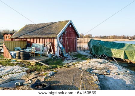 Covered Boat And Boathouse