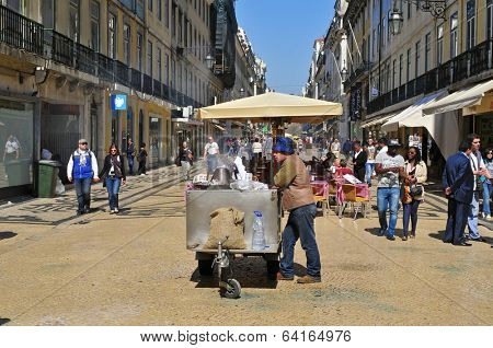 LISBON, PORTUGAL - MARCH 17: Ambiance in Rua Augusta on March 17, 2014 in Lisbon, Portugal. This pedestrian street in Baixa District is one of the busiest in the city