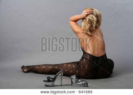Young Woman Posing In Erotic Style
