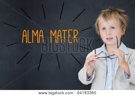 The word alma mater against schoolboy and blackboard
