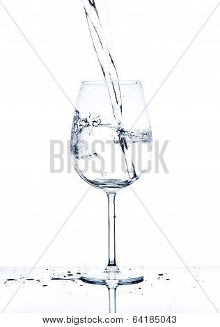 Glass With The Stream Of Dinking Water