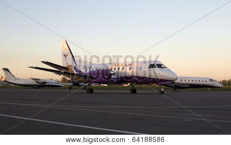 YanAir Saab 340 aircraft running on the runway