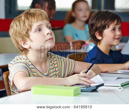 Child in elementary school writing lefthanded in class