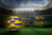 Football in colombia colours against large football stadium with brasilian fans poster