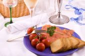 Dinner plate with salmon on a restaurant table poster