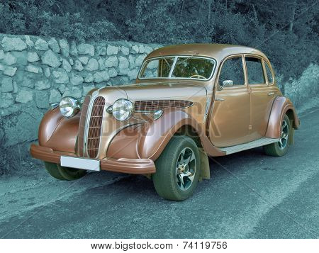 Antique vintage car (colored) on monochromatic background, jpeg file contain clipping path