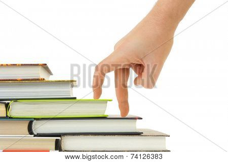 Hand and book stairs isolated on white background
