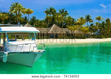 Boat moored at tropical island - travel background