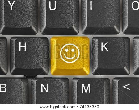 Computer keyboard with smile key - business concept