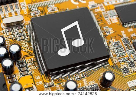 Music note on computer chip - technology concept