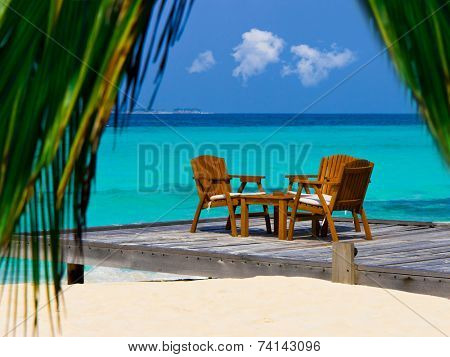 Cafe on the beach, ocean and sky - vacations background