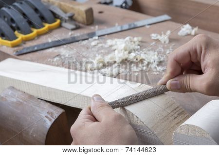 Luthier Filing Down