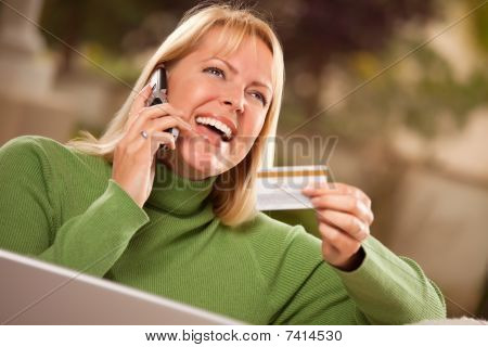 Cheerful Woman On Phone And Laptop With Credit Card