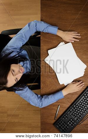 Woman Working At Desk Shot From Above