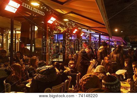 Crowd Of People On A French Terrace