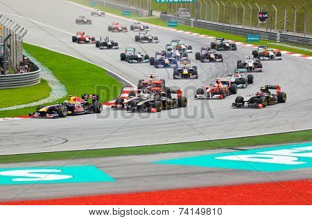 SEPANG, MALAYSIA - APRIL 10: Cars on track at race of Formula 1 GP, April 10 2011, Sepang, Malaysia. First lap.