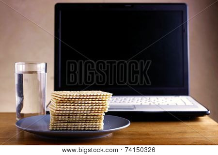 Soda Crackers, Glass of water and a computer