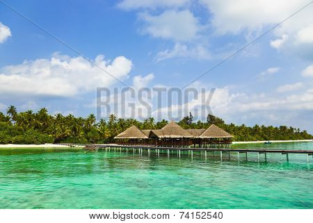 Water cafe on a tropical beach - Maldives travel background