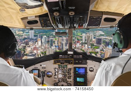 Pilots in the plane cockpit and town