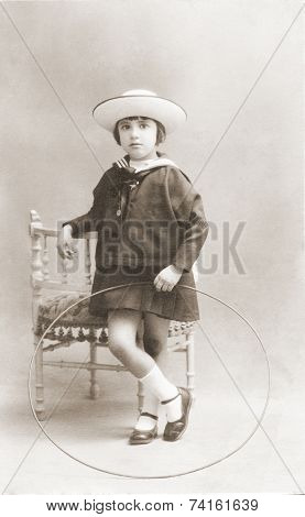 Ancient portrait of of girl in a studio. vintage