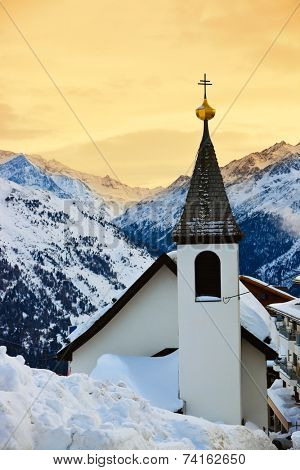 Church at mountains ski resort Solden Austria - nature and architecture background poster