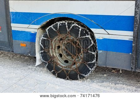 Snow chains on tyre of car - winter transportation