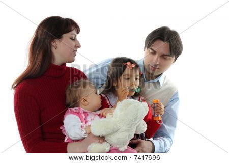 Happy Family: Mother, Father And Two Girls