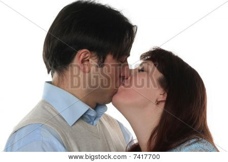 Young Family Couple Kissing Isolated On White, Studio Shot