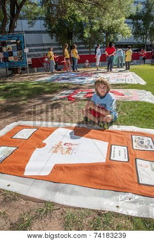Boy With Section Of Aids Quilt