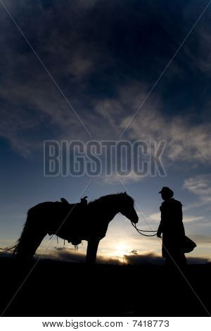 Man And Horse In Sunset
