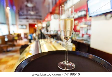 glass of champagne in cafe