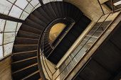 Industrial staircase going up to the tower poster