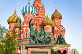 Saint Basil Cathedral on Red square, Moscow (Russia) at sunset poster