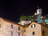 Old fort in Omis, Croatia at night - architecture background poster