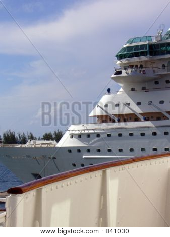 New Cruise Ship Behind Deck Of Vintage Cruise Ship
