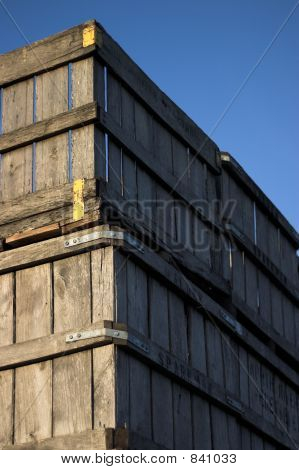 Old Wooden Fruit Crates Against Blue Sky