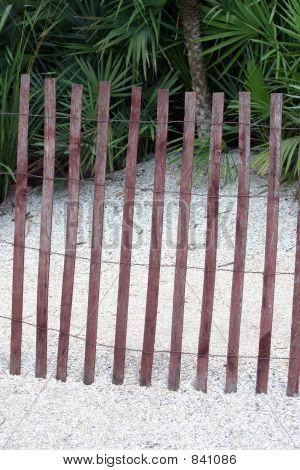 Thin wooded fence at beach