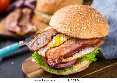Home made burger on wooden board