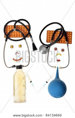 Humorous caricatures of doctors made of a medical stethoscope, tablets, enema of syringes
