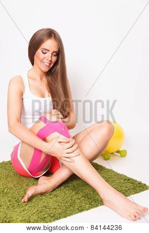 Woman Exercise With Taped Leg